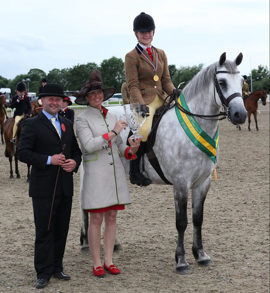 Isabella Worthing French and Inverin Paddy receiving the TopSpec Supreme Pretty Polly Championship Award from judges Cindy Henson and Adam Brooke
